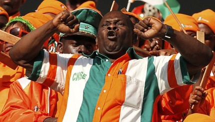 A fan cheers before the start of the 2010 World Cup Group G soccer match between North Korea and Ivory Coast in Nelspruit