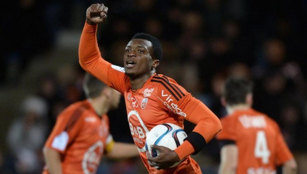 Benjamin Moukandjo celebrates his consolation goal against PSG.