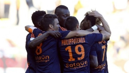 Didier Ibrahim NDong  celebrates with team-mates after opening scoring for Lorient.