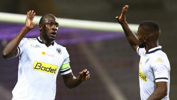 Captain fantastic: Cheikh Ndoye, left, celebrates after heading home for Angers against Toulouse.
